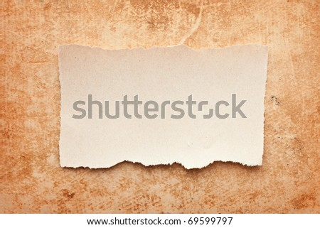 ripped piece of paper on grunge paper background. vintage retro card - stock photo