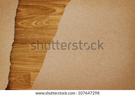 Ripped recycle paper on wood background - stock photo