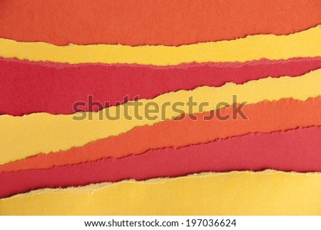Ripped Red and Orange and Yellow Paper in Stripes as a Paper Background