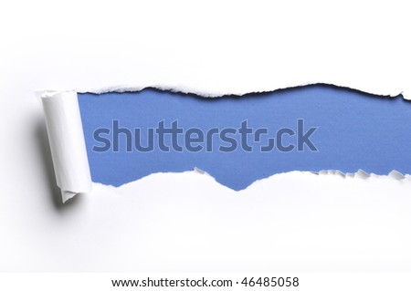 ripped white paper against a blue background - stock photo