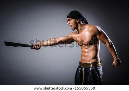 Ripper pirate in the dark room - stock photo