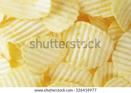 ripple potato chips from above, food background