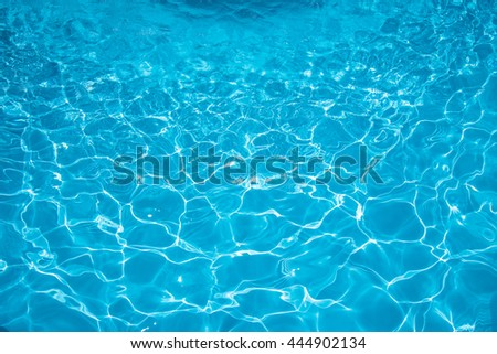 Ripple Water in swimming pool with sun reflection - stock photo