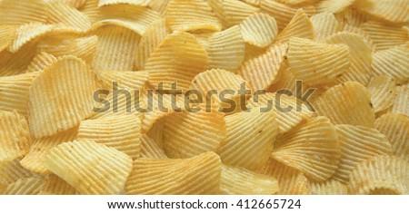 Rippled organic potato chips - stock photo
