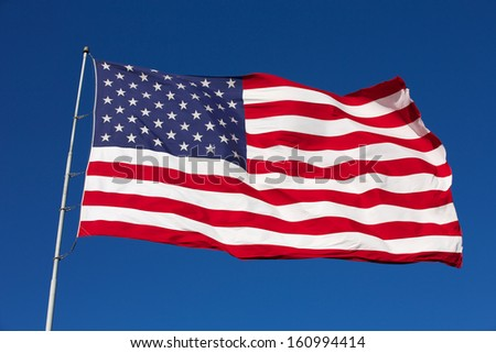 Rippled US Flag on a Windy Day - stock photo