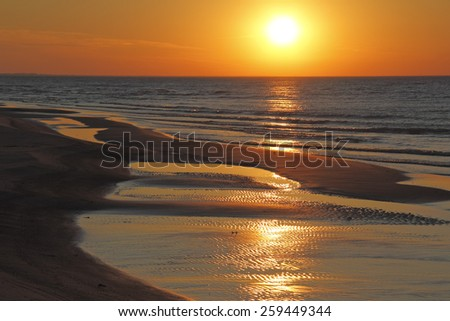 Ripples on Lake Huron Beach at Sunset - Ontario, Canada - stock photo