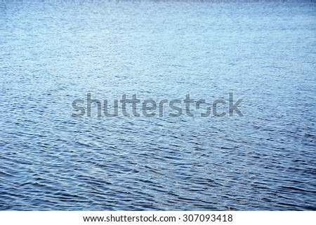 Ripples on the blue water at the wind. Background, texture - stock photo