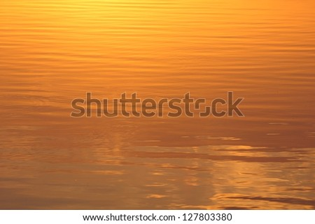 Ripples on Water Lit by Sun - stock photo
