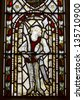 RIPPONDEN, YORKSHIRE - APRIL 9: Medieval stained glass window in St. Bartholomew's, Ripponden, April 9, 2013. In May, there is a 'picnic' to celebrate the feeding of the 5000 at the church. - stock photo