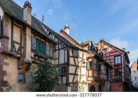 RIQUEWIHR, FRANCE/ EUROPE - SEPTEMBER 24: Colourful buildings in Riquewihr in Haut-Rhin Alsace France on September 24, 2015