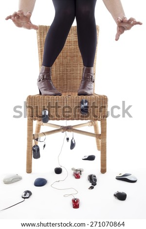 rise to a chair woman being attacked by computer mice, metaphor of phobia - stock photo