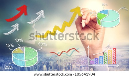 Rising arrows and graphs drawn with chalk sketches - stock photo