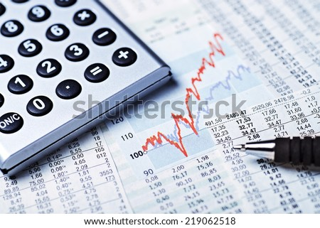 Rising curve with rate tables and calculator as a symbol of rising share prices. - stock photo