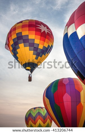 Rising hot air balloons on the early morning sunrise sky