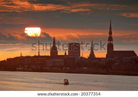 Rising over the river Daugava in Riga, Latvia. - stock photo