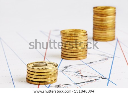 Rising stacks of coins on financial chart. Selective focus