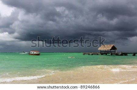 Rising thunder storm at Pigeon Point (Tobago, West Indies) - stock photo