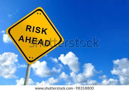 risk ahead traffic sign on bluesky - stock photo