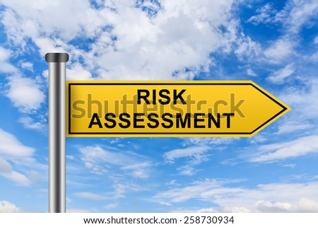 risk assessment words on yellow road sign on blue sky - stock photo