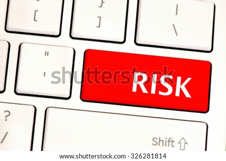 Risk. Computer white keyboard with risk . Computer white keyboard