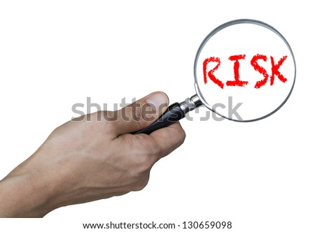 risk concept - hand with magnifying glass (with clipping path)