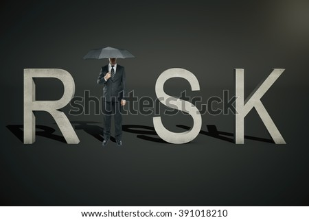 Risk concept of businessman with umbrella replacing letter 'I' in word 'RISK' on black background - stock photo