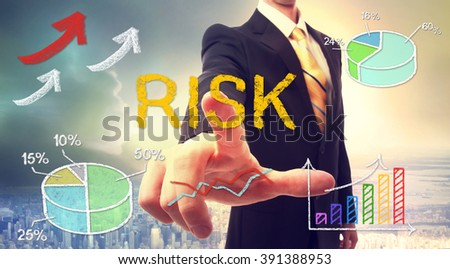 Risk concept with businessman and graphs and arrows