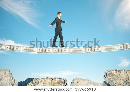 Risk concept with businessman walking on dollar banknote line above rocks - stock photo