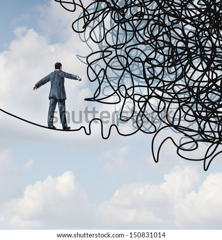 Risk confusion business concept as a businessman on a high wire tight rope walking towards a tangled mess as a metaphor or symbol of overcoming adversity in strategy and finding leadership solutions. - stock photo