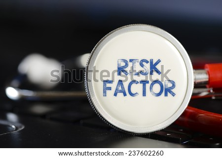 Risk factor and stethoscope. Risk factor sign and stethoscope. Medicine concept on computer keyboards - stock photo