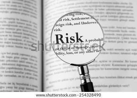 Risk, Holding Magnifying Glass. Studio Shot . - stock photo