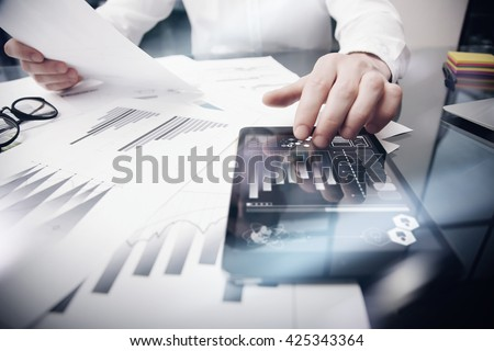 Risk Management Work process.Photo Trader working Market Report Documents Touching Screen Tablet.Using Graphic Icons,Stock Exchanges Reports. Business Project Startup. Horizontal, . - stock photo