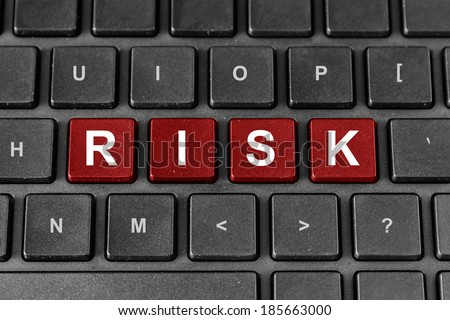 Risk red word on keyboard, business financial concept - stock photo