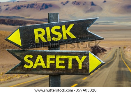 Risk - Safety signpost in a desert background - stock photo