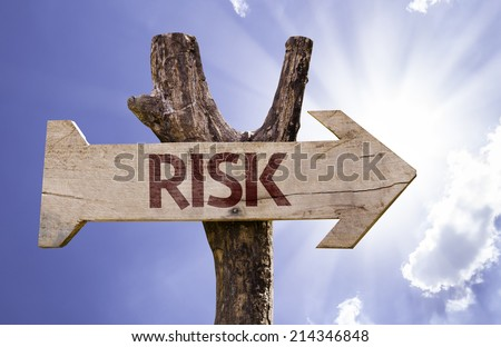 Risk sign with a beautiful day on background - stock photo