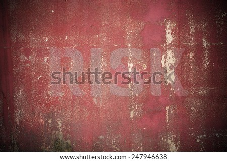 Risk text written on cracked concrete ,vintage wall background - stock photo