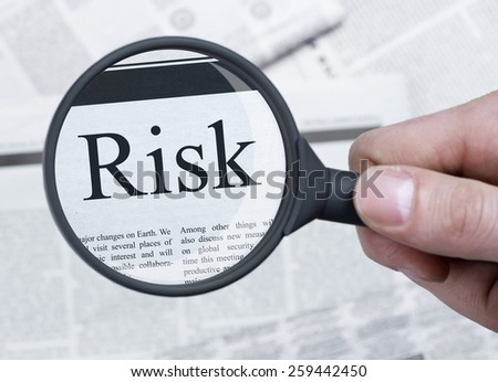 Risk under magnifying glass - stock photo