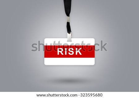 risk with grey radial gradient background - stock photo