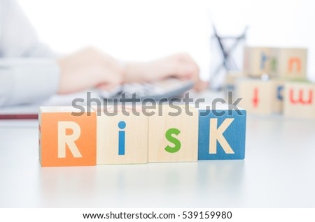 RISK word with colorful blocks. risk business leadership process finance cube blocks concept
