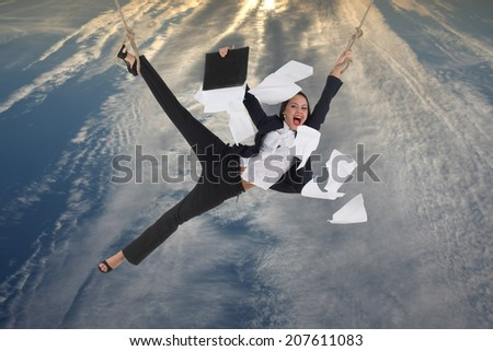 Risking business lady with flying papers near her is soaring above the city