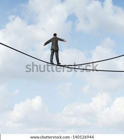 Risky choice business concept with a man walking a dangerous high wire tightrope that is in a crossroads splitting into two opposite directions as a strategy dilemma icon deciding on the best path. - stock photo