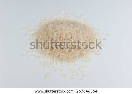 risotto sushi rice uncooked in a heap isolated on a white background - stock photo