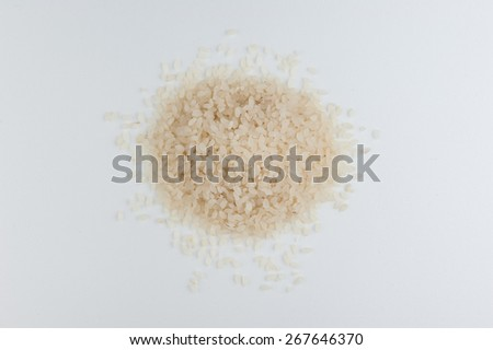 risotto sushi rice uncooked in a heap isolated on a white background. top view - stock photo