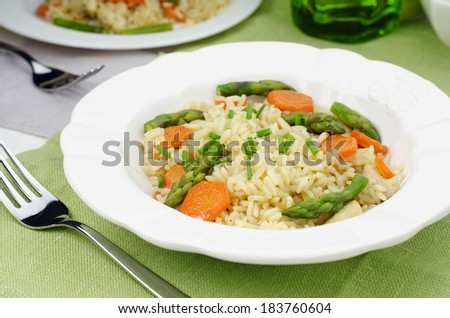 Risotto with asparagus and carrot - stock photo