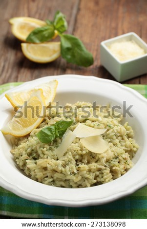 Risotto with basil and Parmesan on a rustic table