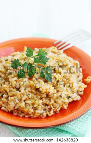 Risotto with chicken and vegetables and parsley