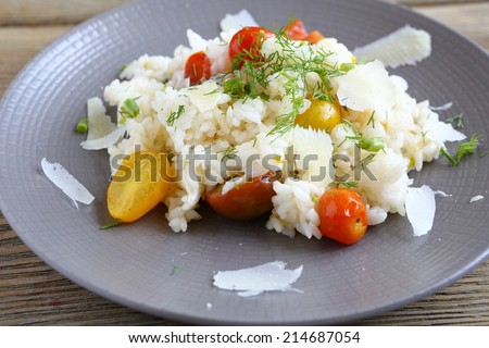 Risotto with fresh vegetables, food closeup