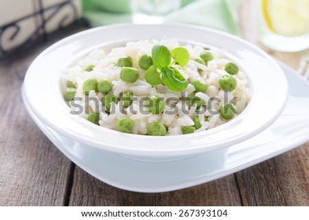 Risotto with green peas - stock photo