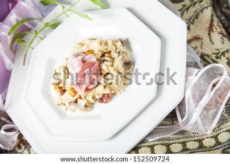 Risotto with mushrooms and bacon,,an elegant table suitable for parties