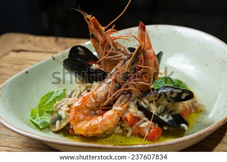 risotto with mussels, prawns and other seafood - stock photo